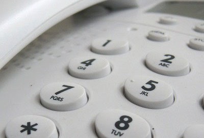 Image of telephone keypad referring that it's good practice to take the lead conference calls.