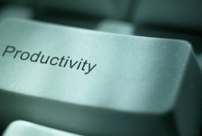 Image of computer key with the word 'productivity', depicting the need to define end user project roles.