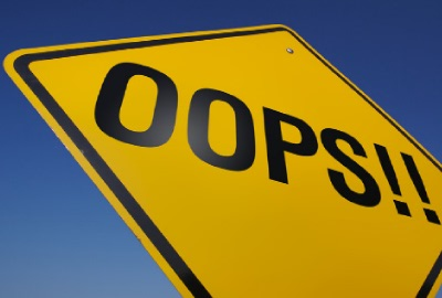 Image of yellow road sign with the word 'OOPS!!', depicting the importance of avoiding management mistakes.