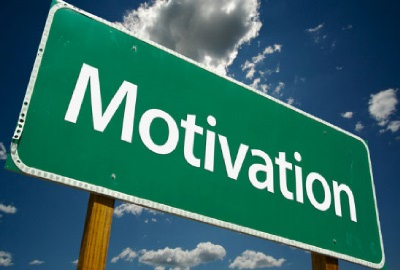 Image of road sign with the word 'motivation' signifying the need to motivate project teams.