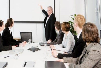 Image of business people in a meeting depicting the need to organize project teams.