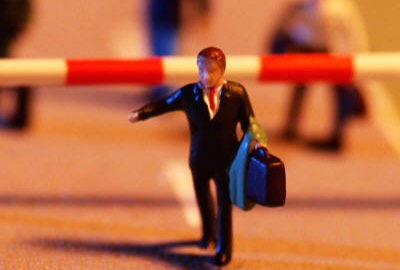 Image of businessman passing a checkpoint signifying the need for project checkpoints.