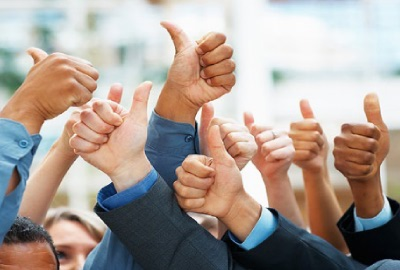 Image of a group of people gesturing 'thumbs up' signifying a successful project closure.