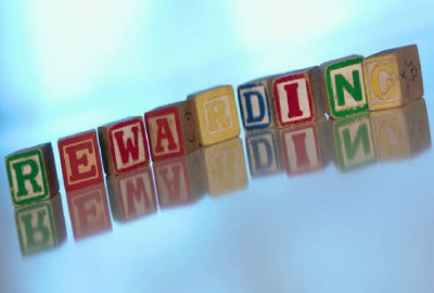 Image of children's alphabet blocks spelling the word 'rewarding' indicating the need to define project deliverables will produce rewarding results.