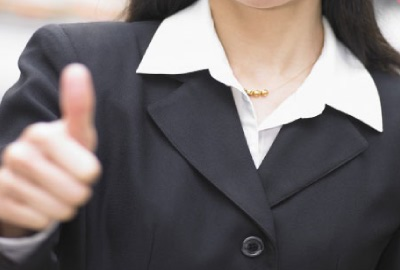 Image of woman giving the 'thumbs up' sign giving the nod to project quality management.