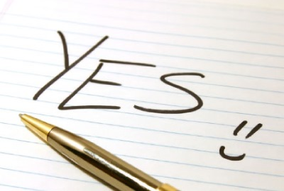 Image of a pad and pen with the word 'Yes!!' representing the need to create project scope templates.