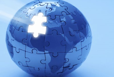 Image of globe made from puzzle pieces with one missing depicting the need to create a responsibilities framework.