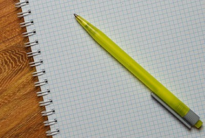 Image of graph pad and pen to be used in defining roles and responsibilities.