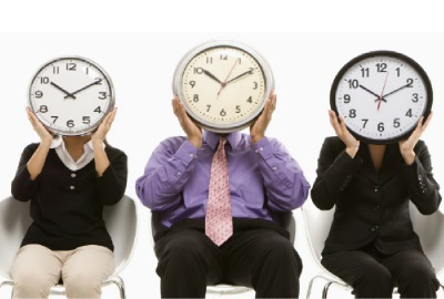 Image of three people with clocks if front of their faces emphasizing the need for relevant time management tips.