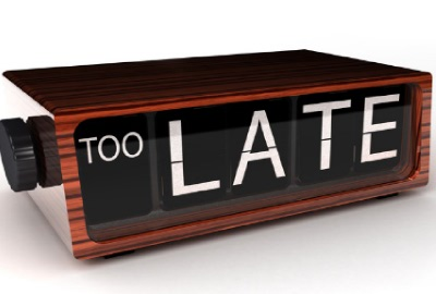 Image of digital flip clock saying 'TOO LATE' signifying the need to manage project delays.