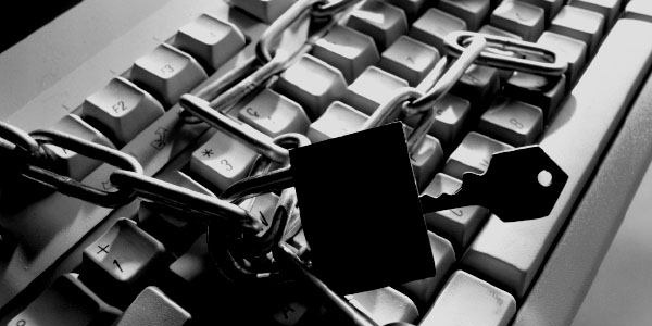 Computer keyboard with chain and padlock to puncuate the need for asset management policies.