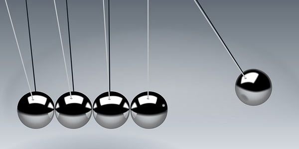 Newton's cradle which demonstrates conservation of momentum and energy using a series of swinging spheres, signifying the importance to balance end-user needs.