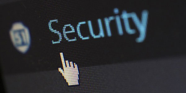 Image of computer monitor with the hand cursor pointing to the word 'Security', depicting the need for data security policies.