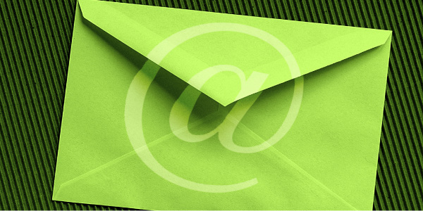 Image of the back of a greeting card size envelope embossed with an '@' symbol which is used to depict email policies.