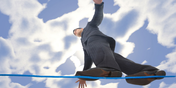 Image of man walking on a tightrope, signifying the need to manage limited resources.