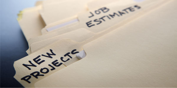 Image of file folders labeled 'new projects' and 'job estimates' depicting the need to make winning project proposals.