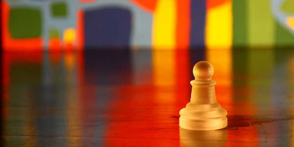 Image of chess pawn representing project risk management.