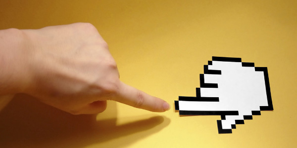 Image of persons finger and cursor hand pointing to each other signifying the need to employ technology standards.