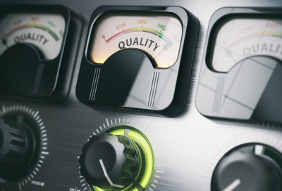 Image of control panel meter labeld 'quality' depicting the need to evaluate the cost of quality in projects.