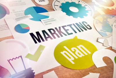 Image of symbols and papers depicting marketing and planning in providing help desk services and support.