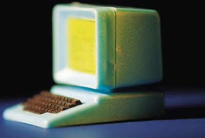 Image of computer terminal on desk signifying the need for asset management controls.