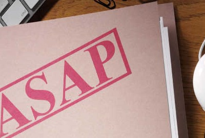Image of computer keyboard and mouse with a closed file folder over the keyboard labeled 'ASAP', depicting the need to take steps to control project risk.