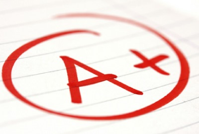 Image of report card with a grade of 'A+' signifying the need to apply lessons learned techniques to projects.