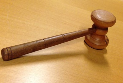 Image of gavel indicating the need to have project governance plans.